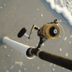 surf fishing rod and reel on the shore