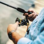 angler holding a spinning rod and reel