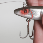 hand holing a fishing lure