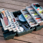 open fishing tackle box on plank