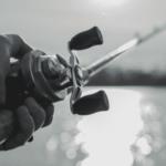 angler using baitcasting reel in open water