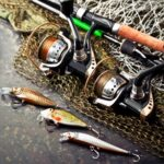 fishing rods and fishing reels with accessories on the table