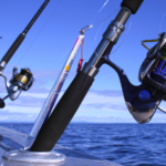 spinning reels and rods on boat spread in the middle of the ocean